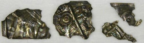 Fragments of silver foil from the Staffordshire Hoard during conservation at Birmingham Museums and Art Gallery