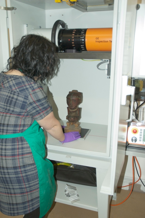 Nkisi figure being place in the x-ray machine