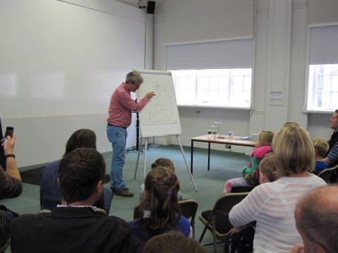 Axel Scheffler illustrating in front of a crowd