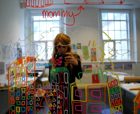 The mirror within the studio with illustrations on it