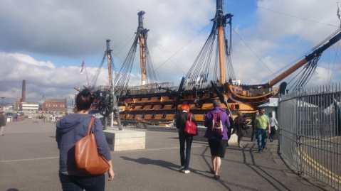 The conservation team passing the HMS Victory replica
