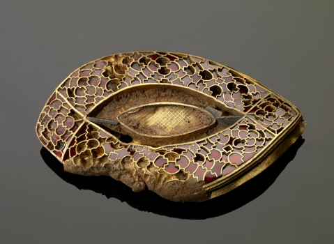 Lens shaped gold and garnet fitting from the Staffordshire Hoard.
