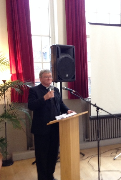The Dean of St Albans, Dr Jeffrey John, proposing a toast to Hughes