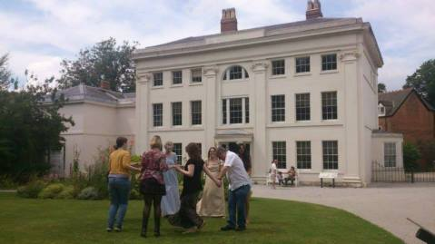 Visitors learning Regency dance steps.