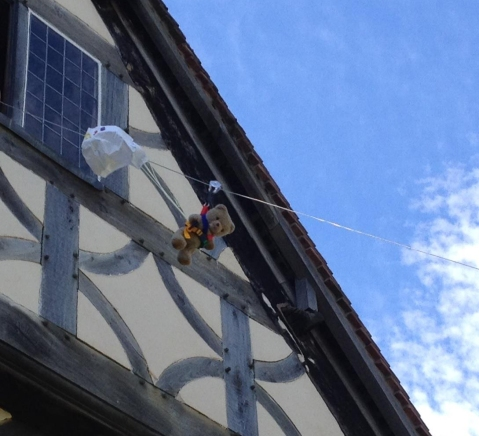 Teddy parachuting out of the window at Blakesley Hall