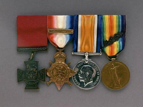 Victoria Cross (at left), the 1914 Star with the 'Mons' bar, the British War Medal, and the Allied Victory Medal, awarded to Corporal Charles Alfred Jarvis, Royal Engineers.