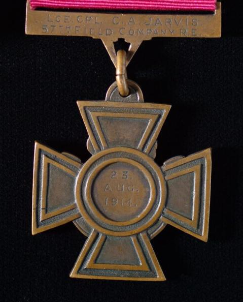 Detail of the reverse of the Victoria Cross, showing the name C.A.JARVIS and the date the medal was awarded, 23 AUG 1914.