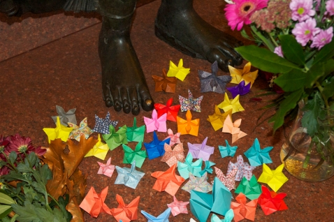 Origami lotus flowers left at the feet of the Buddha by visitors to the Museum, October 2014