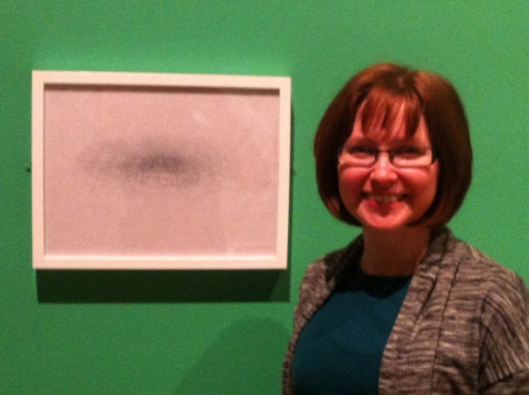 Nita Newman with her artwork Far above the clouds #1