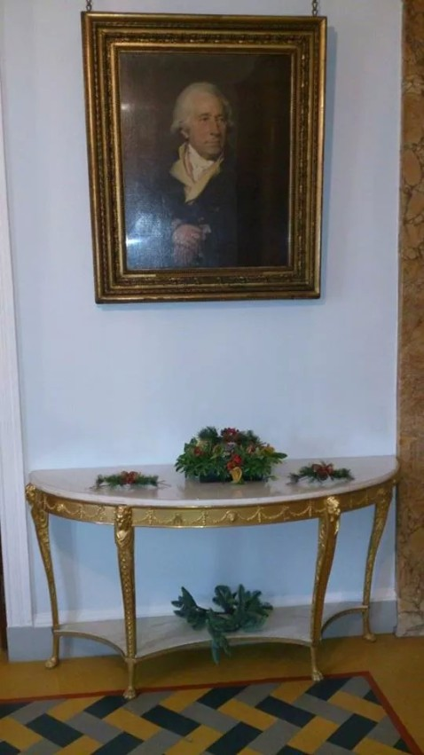 Entrance hall of Soho House and portrait of Matthew Boulton decorated with evergreen