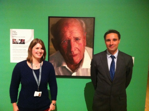 Robert Neil in front of his artwork 'John' with Exhibition Officer Katie Hall